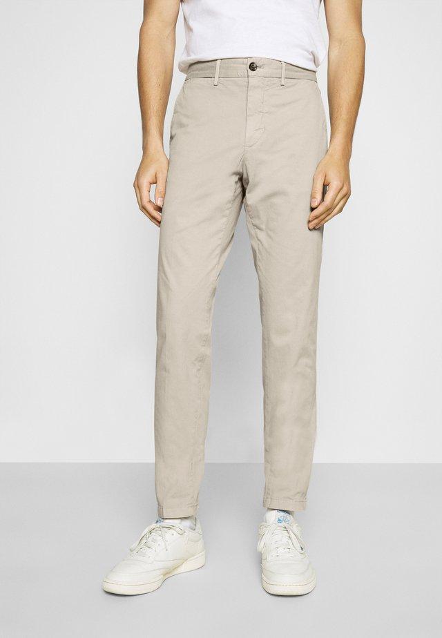 FLEX - Trousers - sand