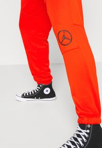Jordan - PANT - Tracksuit bottoms - chile red/black - 3