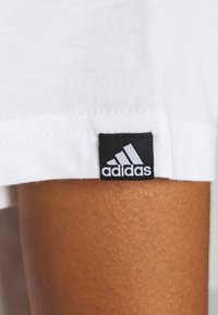 adidas Performance - CIRCLED TEE - Printtipaita - white - 5