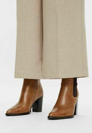 BIAJUDIA  - High heeled ankle boots - beige