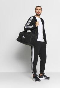adidas Performance - veste en sweat zippée - black/white - 1