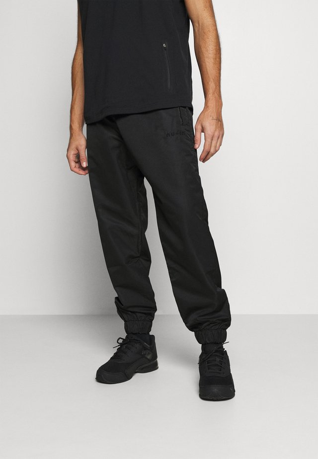 SHELL JOGGERS - Tracksuit bottoms - black