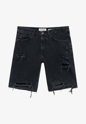 MIT ZIERRISSEN AM BEIN - Denim shorts - mottled black