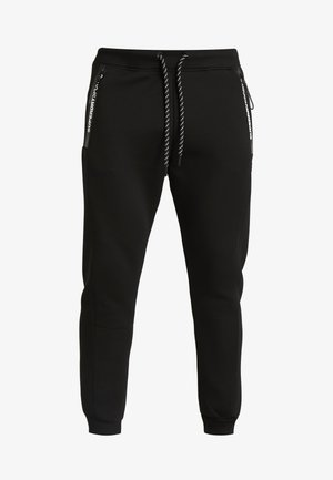 CORE GYM TECH - Jogginghose - black