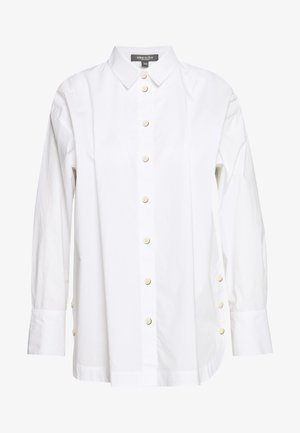 BLOUSE WITH SLIT DETAIL - Button-down blouse - white