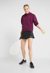 Nike Performance - DRY SKIRT - Sportovní sukně - black/white - 1