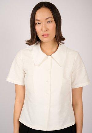 DUNA  - Button-down blouse - off-white