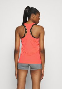 Nike Performance - TANK ALL OVER  - Sports shirt - bright mango/white - 2