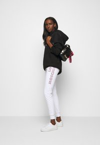 Love Moschino - Tracksuit bottoms - white - 1