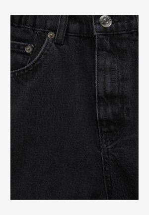 MIT GUMMIZÜGEN - Denim shorts - black