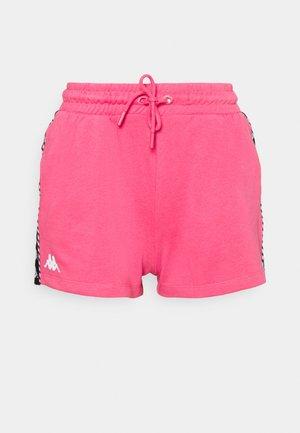 IRISHA - Sports shorts - honeysuckle