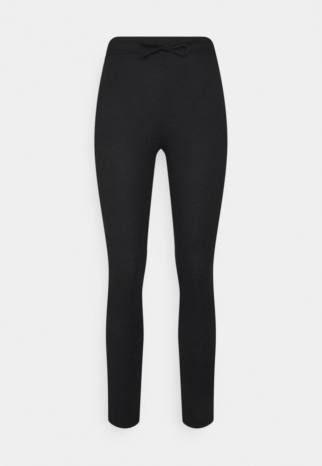 ADELE - Leggings - black