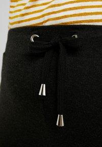 ONLY Carmakoma - CARCARMA PANTS - Verryttelyhousut - black/melange - 6