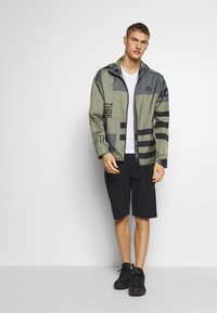 adidas Performance - URBAN ALLOVER PRINT WIND.RDY  - Outdoor jacket - green - 1