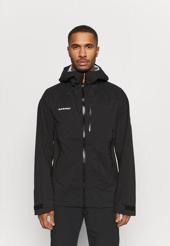 KENTO HOODED JACKET MEN - Waterproof jacket - black/white