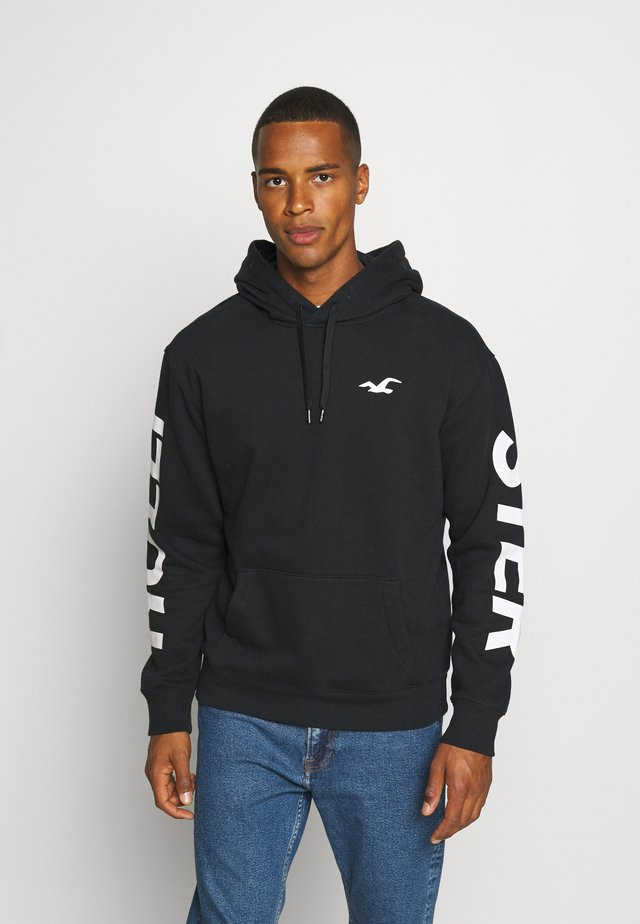 ICONIC PRINT - Sweat à capuche - black