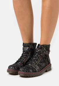 Rieker - Lace-up ankle boots - black - 0