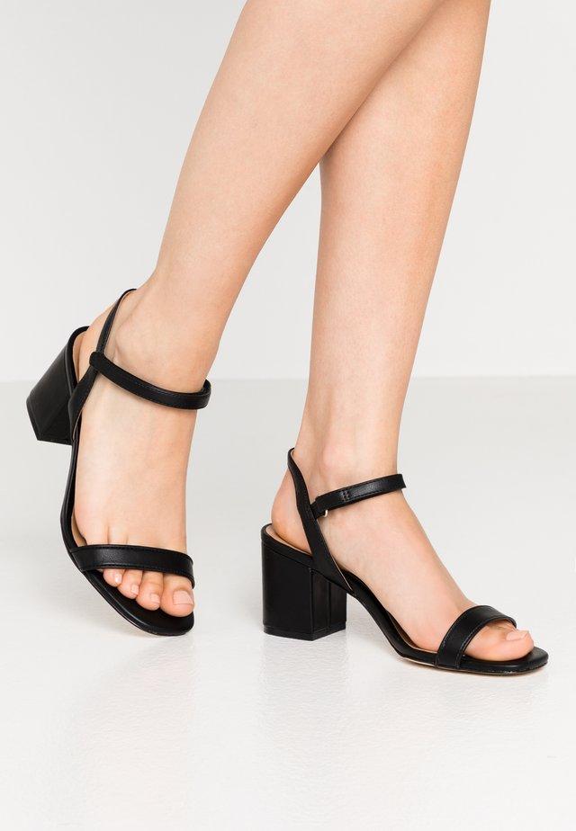 ELERANG - Sandaalit nilkkaremmillä - black