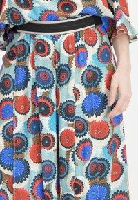 Nicowa - MIT GESCHLITZEM BEIN - Trousers - blue - 4