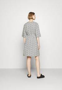 Marimekko - IHMETYS PIKKUINEN UNIKKO DRESS - Day dress - black/off-white - 2