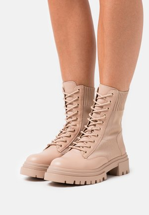 REFLOW - Lace-up ankle boots - bone