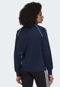 adidas Originals - PRIMEBLUE SST TRACK TOP - Training jacket - blue - 1