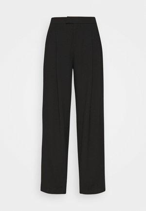 DUA LIPA x PEPE JEANS - Trousers - black