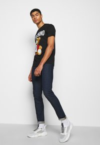 MOSCHINO - TROUSERS - Slim fit jeans - fantasy blue - 3