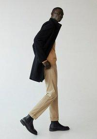 Mango - FUNNEL-I - Classic coat - schwarz - 3