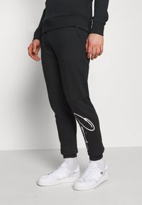 Jack & Jones - JORSCRIPTT PANTS  - Verryttelyhousut - black - 3
