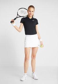Nike Performance - DRY SKIRT - Sports skirt - white/black - 1