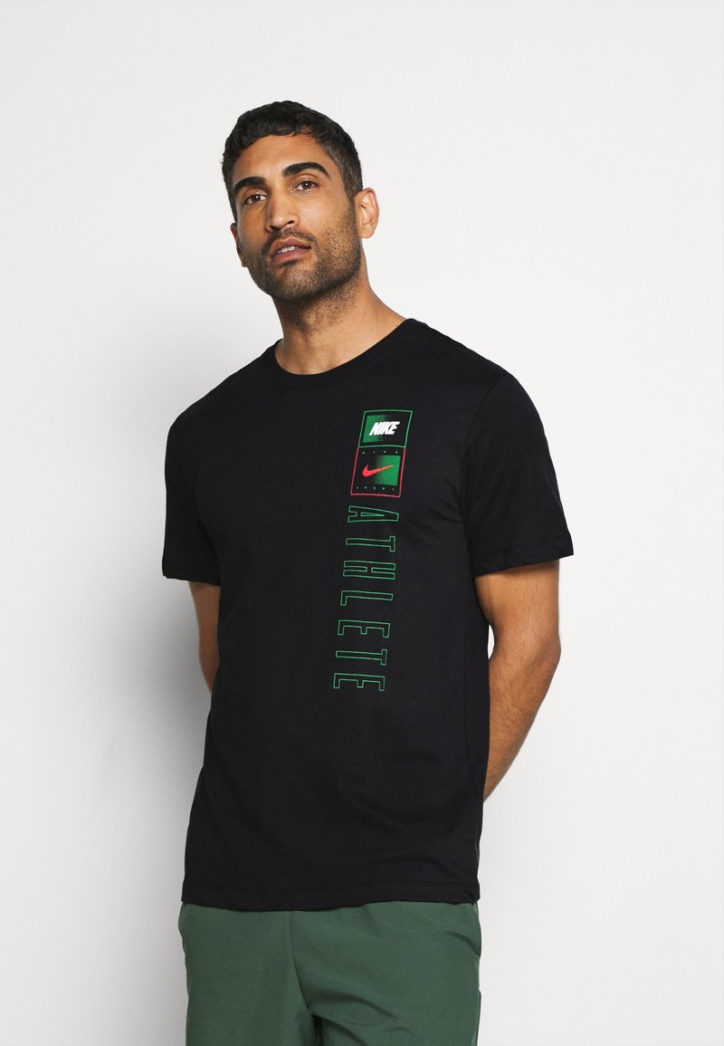 Nike Performance - TEE TEAM - T-shirt print - black