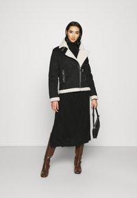 ONLY - ONLDIANA BONDED AVIATOR JACKET - Faux leather jacket - black/white - 1