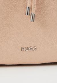 HUGO - VICTORIA - Across body bag - pink - 4