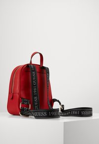 Guess - CALEY BACKPACK - Rucksack - red - 1