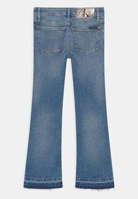 Calvin Klein Jeans - FLARE INFINITE  - Bootcut jeans - denim - 1