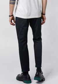 Tigha - Trousers - vintage black - 2