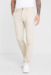 Kjus - MEN IKE PANT - Trousers - oxford tan - 0