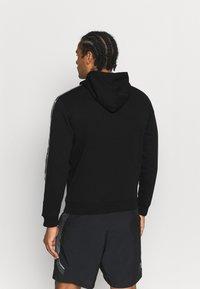 Champion - HOODED  - Sweatshirt - black - 2
