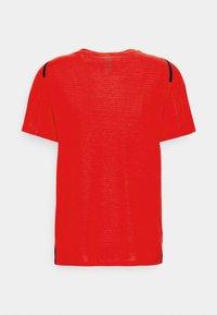 Nike Performance - T-shirts med print - university red/black - 6