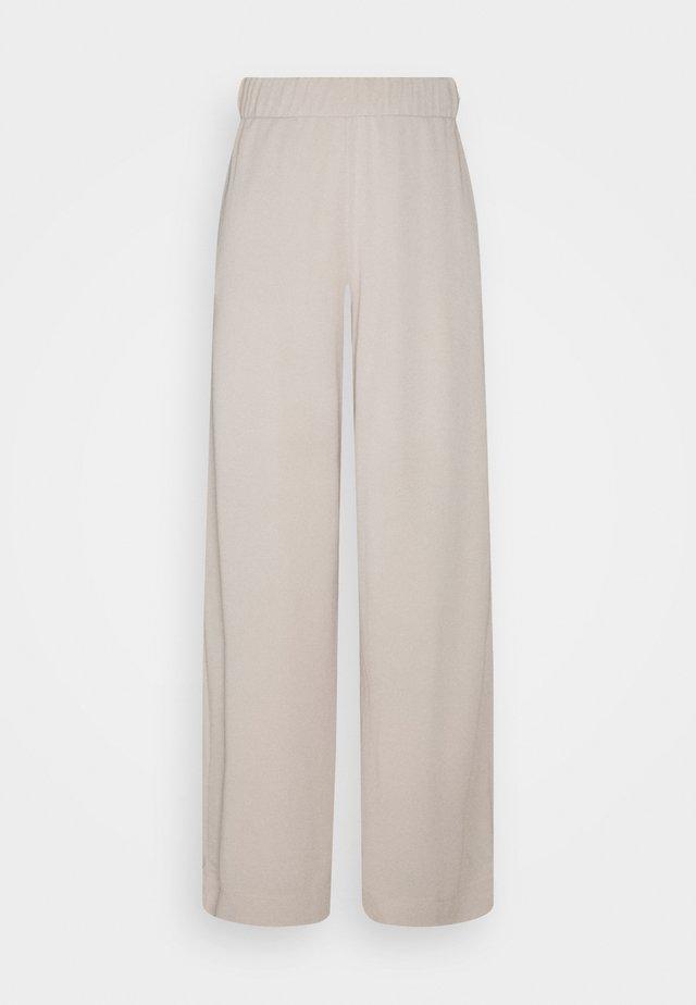 CLEO TROUSERS - Pantaloni - beige dusty light