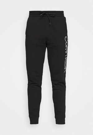 LOGO PANTS - Jogginghose - black