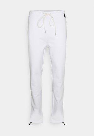 DAGGER PANT UNISEX - Tracksuit bottoms - white