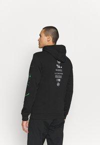 adidas Performance - X CITY HOODY - Sweatshirt - black - 2