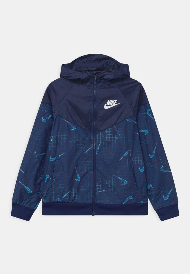 Treningsjakke - blue void/barely volt