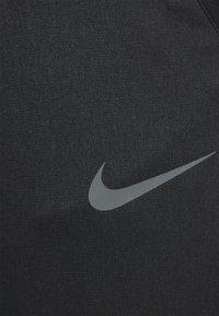 Nike Performance - PANT CAPRA - Tracksuit bottoms - black/iron grey - 4