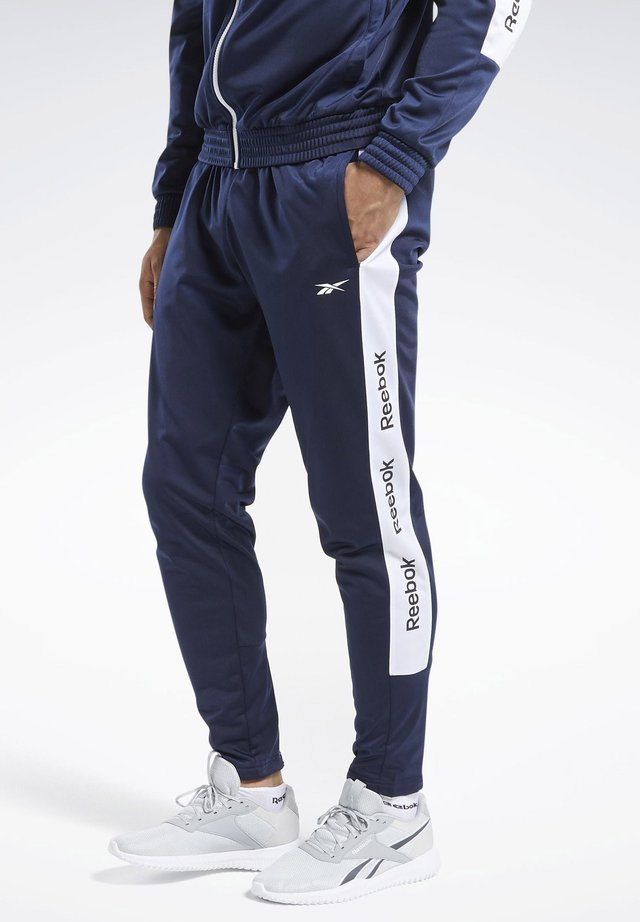 TRAINING ESSENTIALS TRACK JOGGERS - Joggebukse - blue