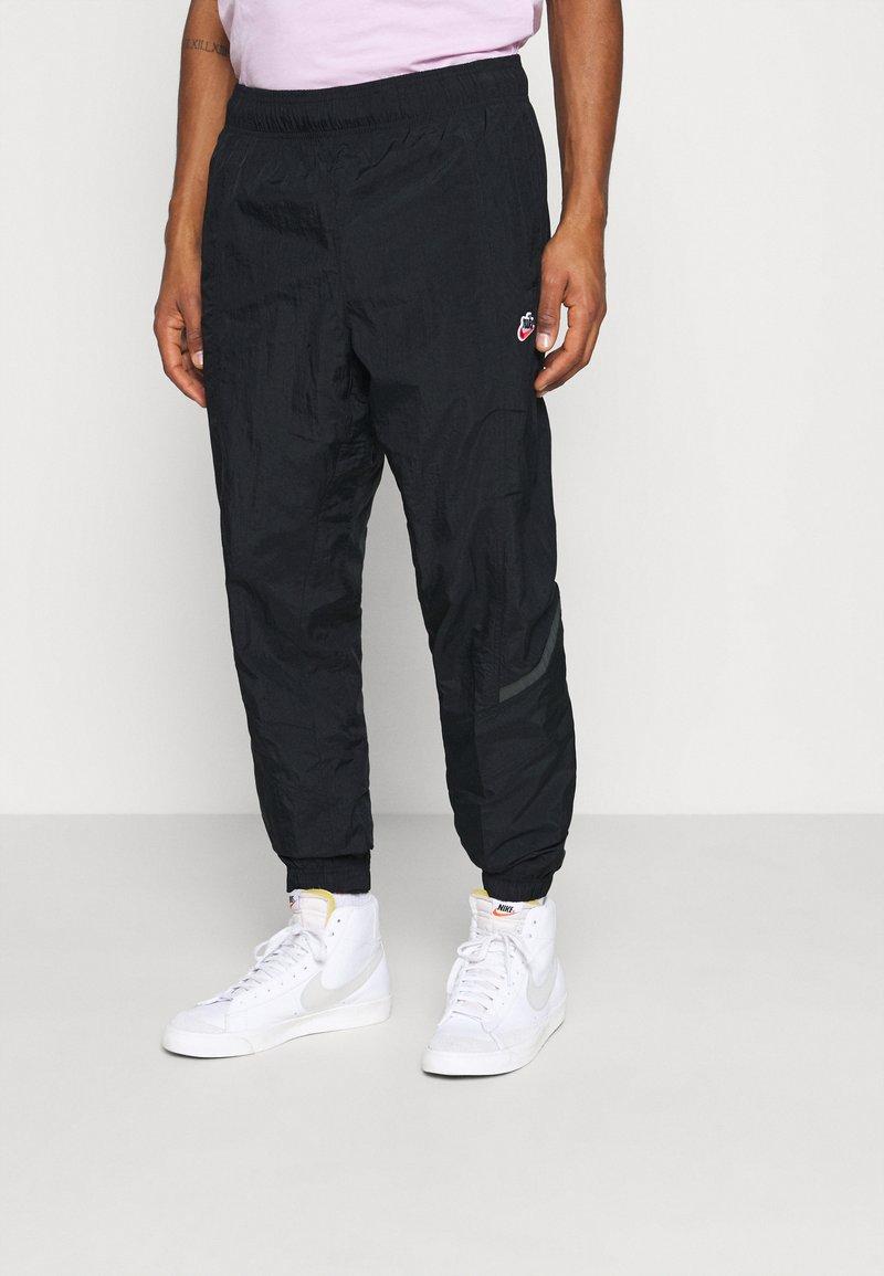 Nike Sportswear - PANT - Tracksuit bottoms - black
