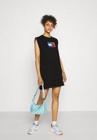 Tommy Jeans - LOGO FLAG TEE DRESS - Jersey dress - black - 1