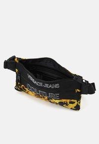 Versace Jeans Couture - UNISEX - Bum bag - black/gold - 4